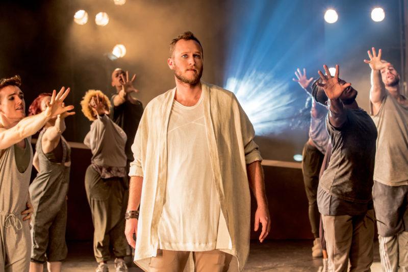 Jesus Christ walks among a crowd of admirers